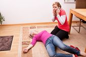 stock photo of collapse  - female senior collapsed young woman calling help - JPG
