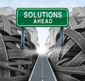 image of confusing  - Solutions ahead and business answers concept with a green highway sign as an icon of breaking out from a confusion of tangled roads with a clear strategic path - JPG