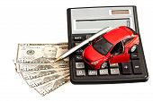 stock photo of plastic money  - Toy car money and calculator over white - JPG