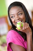 stock photo of healthy eating girl  - casual woman with an apple at the supermarket - JPG