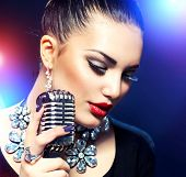 stock photo of singer  - Singing Woman with Retro Microphone - JPG