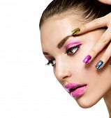 Fashion Beauty. Manicure and Make-up. Nail art. Beautiful Woman With Colorful Nails and Luxury Purpl