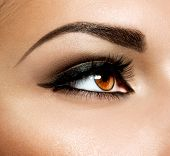 stock photo of blinking  - Brown Eye Makeup - JPG
