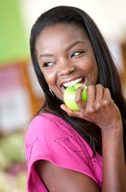 picture of healthy eating girl  - casual woman with an apple at the supermarket - JPG