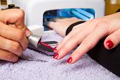 foto of uv-light  - manicure and Hands with uv lamp for nails - JPG