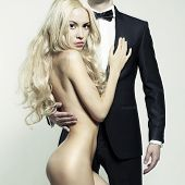 image of beautiful lady  - Fashionable photo of beautiful naked lady and man in suit - JPG
