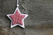 picture of elm  - Christmas handmade decoration Shabby Chic wooden star with gingham fabric pattern over rustic Elm wood background  - JPG