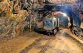 image of catacombs  - Underground mine with a truck and railroad - JPG