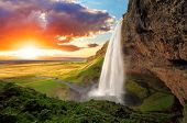 stock photo of wild adventure  - Seljalandsfoss is one of the most beautiful waterfalls on the Iceland - JPG