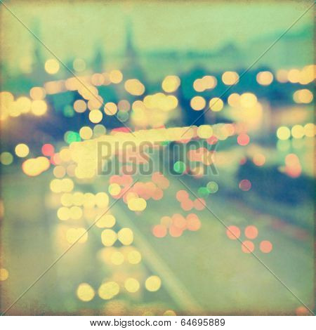 Abstract blurred cityscape background with bokeh effect. Grunge and retro style.  poster