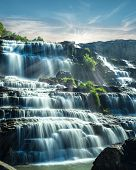foto of lats  - Tropical rain forest landscape with flowing blue water of Pongour waterfall at sunny day under blue sky - JPG