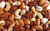 picture of mixed nut  - Background texture of assorted mixed nuts including cashew nuts pecan nuts almonds - JPG