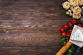 foto of carbohydrate  - Overhead view of ingredients for an Italian pasta recipe on rustic wood background - JPG