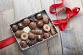 picture of truffle  - assorted chocolates confectionery in their gift box with red bow - JPG