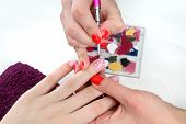 picture of finger-painting  - Finger nail treatment painting flower with brush and lacquer - JPG