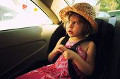 stock photo of seatbelt  - Three year old girl sitting in car seat - JPG
