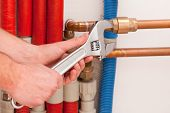 stock photo of pipe wrench  - Wrench valves and pipes in boiler room - JPG