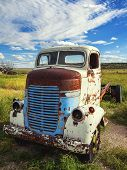 foto of truck farm  - Abandon for years and old truck rusts on a farm - JPG