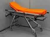 stock photo of stretcher  - Modern orange multi functional aluminum ambulance stretcher - JPG