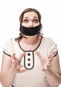 picture of gag  - Beautiful brunette plus size woman gagged and scared isolated - JPG