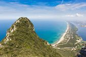 foto of promontory  - View of coastal sand strip and Lake Paola from the limestone cliffs of the Mount Circeo Lazio Italy - JPG