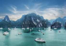 pic of southeast  - Tourist junks floating among limestone rocks at early morning in Ha Long Bay South China Sea Vietnam Southeast Asia - JPG