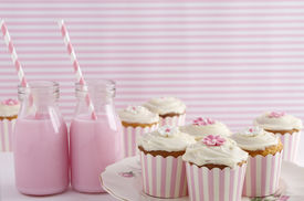 stock photo of girlie  - Pink retro striped theme dessert table at a girls birthday party horizontal - JPG