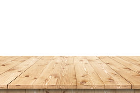 stock photo of timber  - Empty wooden table in a sun drenched summer garden for product placement or montage with focus to the table top in the foreground - JPG