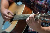 pic of fret  - close up of a male musician playing acoustic guitar - JPG