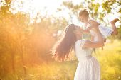 picture of maternal  - Happy young pregnant mother and her little daughter have fun in summer nature - JPG