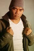 stock photo of filipino  - young man filipino  dressed up with winter clothing - JPG