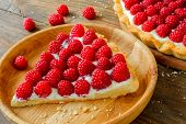 pic of tarts  - Delicious red raspberry tarts on a wooden board - JPG