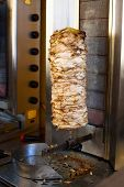 stock photo of gyro  - Grilled meat used for making a traditional greek gyros stuffed sandwich - JPG