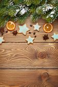 picture of christmas spices  - Christmas wooden background with snow fir tree - JPG