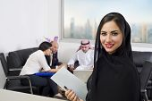 image of eastern culture  - Arabian Businesswoman attending a meeting with business people of different cultures - JPG
