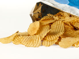 stock photo of potato chips  - Generic open bag of rigged type potato chips  - JPG