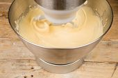 foto of food preparation tools equipment  - Food processor with beater tool preparing dough for a cake - JPG