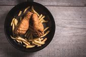 stock photo of fried chicken  - Fried chicken legs and french fries in the panblank space on the right side - JPG