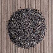 image of opiate  - Top view of poppy seeds against beige vinyl background - JPG
