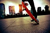 stock photo of legs air  - skateboarder legs skateboarding trick ollie at city skate park - JPG