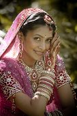 picture of indian beautiful people  - Young beautiful Hindu Indian bride in traditional gown outdoors in garden - JPG
