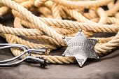 image of spurs  - Sheriff badge spurs and lasso - JPG