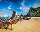 pic of long beach  - Long tail boats on tropical beach  - JPG