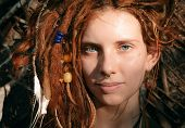 picture of dreadlocks  - Close up Pretty Young Woman Face with Dreadlocks and Piercing Looking at the Camera - JPG