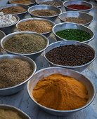 pic of cumin  - Various spices such as pepper curry cumin coriander with various colors on an egyptian market - JPG