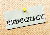 picture of democracy  - Recycled paper note pinned on cork board - JPG