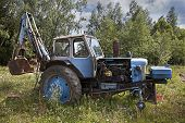 image of neglect  - Neglected old farm tractor rusty and broken - JPG