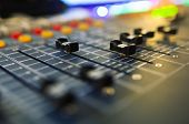 image of mixer  - Part of an audio sound mixer with buttons and sliders - JPG