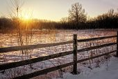 foto of split rail fence  - A snowy winter sunrise scene along a rural country road. Includes fresh snow and a split rail fence. ** Note: Visible grain at 100%, best at smaller sizes - JPG