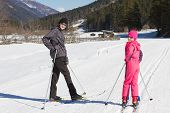 picture of nordic skiing  - Teen boy and little girl cross country skiing in Alp - JPG